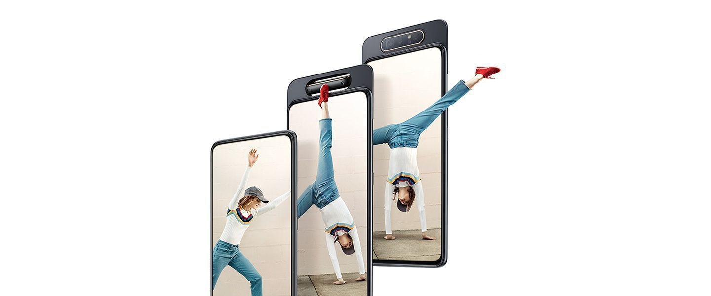 Woman does cartwheel out of Galaxy A80 to show how the smartphone brings content to life.