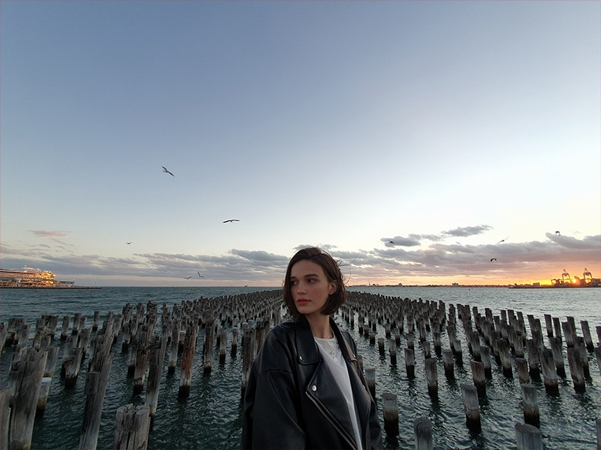 Samsung Galaxy S10 Rear Camera Ultra-Wide 123 Degree Camera Lens - Woman Near Old Dock Next to the Sea, Sunset and Seagulls