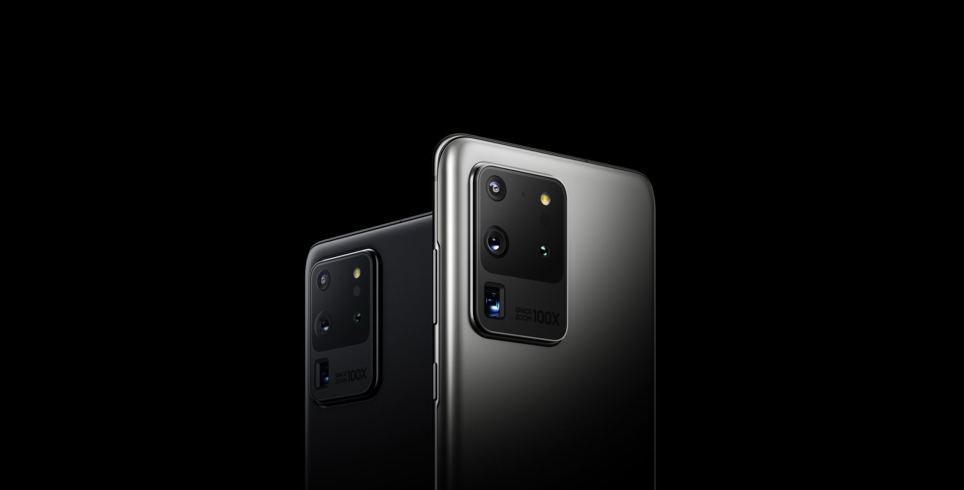 Two Galaxy S20 Ultra phones, one in Cosmic Black and one in Cosmic Gray, seen from the rear at three-quarter angles. They turn towards each other and one disappears behind the other, so one is seen from the rear straight on. White sweeps in until all that can be seen is the rear quad camera