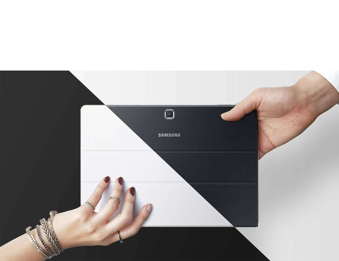 Galaxy TabPro S white held by a woman's hand, black by a man's hand