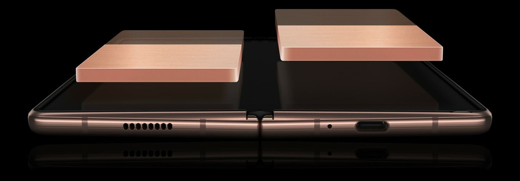 Galaxy Z Fold2 in Mystic Bronze, unfolded and laying faceup. The two sides of the All-day Dual Battery appear floating over the Main Screen, and the color reduces to demonstrate how the dual battery works as one to equally drain power.